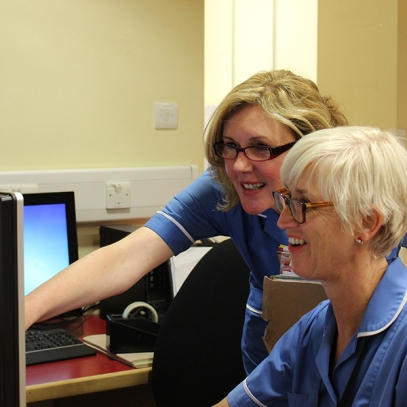 Image of two nurses at a computer
